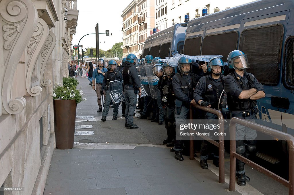 Police in riot gear provide security for the German Embassy as 5000 people protesting and marching for the right to housing march against the policy of evictions and actions of Francesco Paolo Tronca, Special Commissioner of Rome on May 28, 2016 in Rome, Italy.