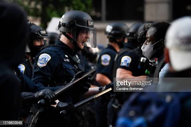 Police in riot gear react to demonstrators as they gather to protest the death of George Floyd near the White House in Washington on Sunday May 31...