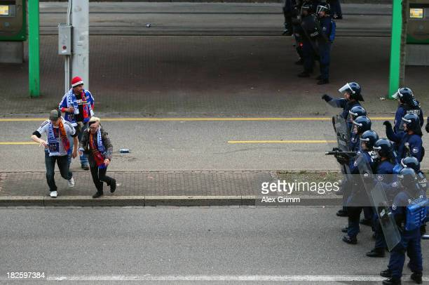 Police in riot gear seperate the fans prior to the UEFA Champions League Group E match between FC Basel 1893 and FC Schalke 04 outside St JakobPark...