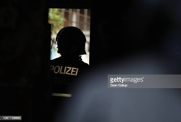 Police in riot gear stand at the entrance to Rigaer Strasse 93 where colleagues had conducted a raid in an apartment earlier in the morning on...