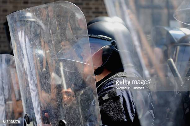 Police in riot gear stand by as protestors demonstrate following a not guilty verdict on September 15 2017 in St Louis Missouri Protests erupted...