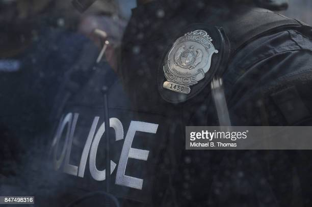 Police in riot gear stand by as protestors demonstrate following a not guilty verdict on September 15, 2017 in St. Louis, Missouri. Protests erupted...