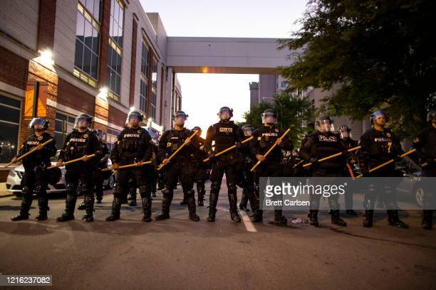Police in riot gear stand in formation during protests on May 29 2020 in Louisville Kentucky Protests have erupted after recent policerelated...