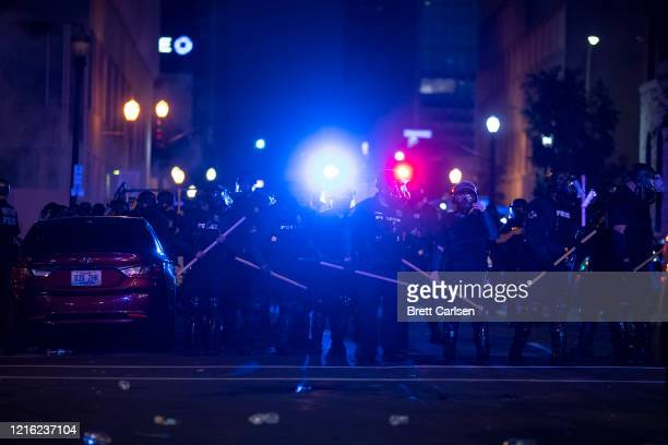 Police in riot gear stand in formation during protests on May 29, 2020 in Louisville, Kentucky. Protests have erupted after recent police-related...