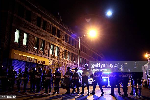Police in riot gear stand on on the street after Baltimore authorities released a report on the death of Freddie Gray on May 1 2015 in Baltimore...