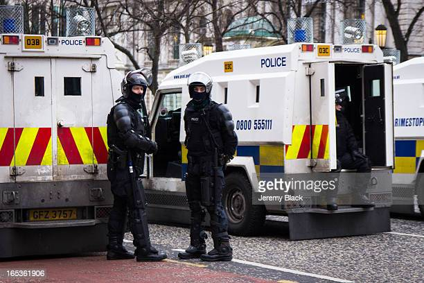 CONTENT] Police in riot gear wait by their Land Rovers during a protest by loyalists at City Hall Belfast Northern Ireland on January 5 2013 The...