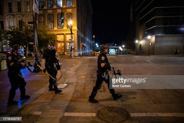 Police in riot gear walk down Main Street to disperse protesters on May 30, 2020 in Louisville, Kentucky. Protests have erupted after recent...