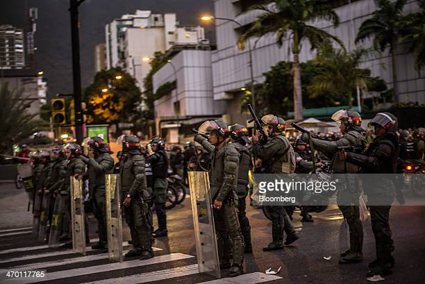 Police in riot gear with tear gas guns stand in a line during a demonstration by a group made up of mostly students in Caracas Venezuela on Monday...