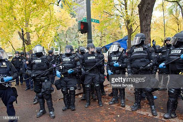 Police in riot gear work to remove remaining protesters from the streets around the Occupy Portland encampment November 13 2011 in Portland Oregon...