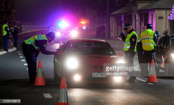 Police in the southern New South Wales border city of Albury check cars crossing the state border from Victoria on July 7, 2020 as authorities close...