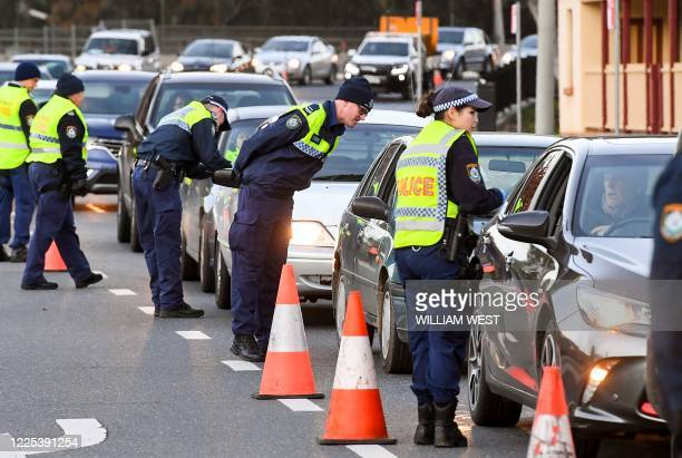 Police in the southern New South Wales border city of Albury check cars crossing the state border from Victoria on July 8, 2020 after authorities...