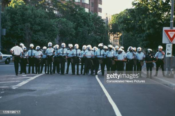 Police in Washington DC, during the riots which followed the acquittal of the four police officers who had arrested and beaten construction worker...
