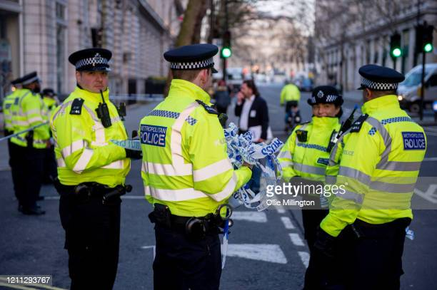 Police in Whitehall at the site where a man has been shot dead by police in whitehall overnight on March 9, 2020 in London, England. A man acting...