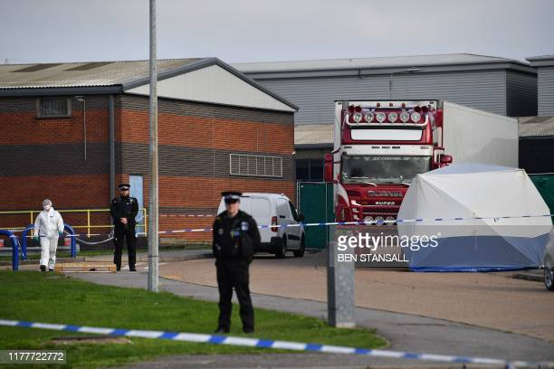 Police including an officer in a forsensic suit secure and investigate a lorry believed to have originated from Bulgaria and found to be containing...