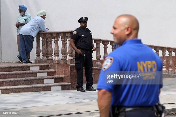 Police increase their presence at the Sikh Cultural Center in Richmond Hill Queens in New York on August 6 2012 The extra security is in response to...