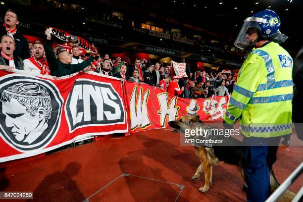 Police inside the stadium keep an eye on Cologne supporters in the stands as the kick off is delayed due to crowd safety issues ahead of the UEFA...