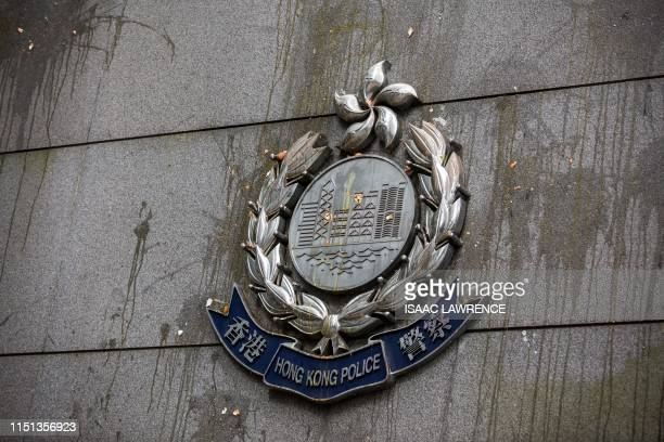Police insignia is covered in egg thrown by protesters at the police headquarters in Hong Kong on June 22 2019 Hong Kong police on June 22 slammed...