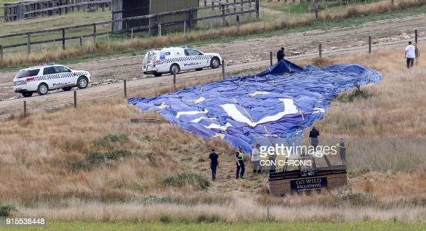 Police inspect a hot air balloon after it crashed during a dawn tour at Dixons Creek some 60 kilometres north of Melbourne on February 8 2018 Seven...