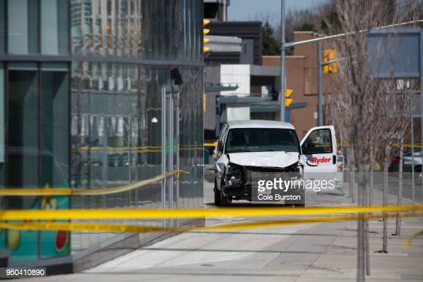 Police inspect a van suspected of being involved in a collision injuring at least eight people at Yonge St and Finch Ave on April 23 2018 in Toronto...
