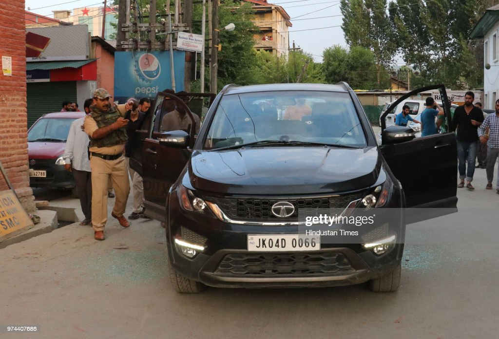 Police inspect damaged car of senior journalist Shujaat Bukhari, who was shot dead by unidentified gunmen outside his office at Press Colony, on June 14, 2018 in Srinagar, India. Bukhari was in his vehicle outside his office at Press Enclave when he came under fire. Two of his personal security officers were also injured in the attack.