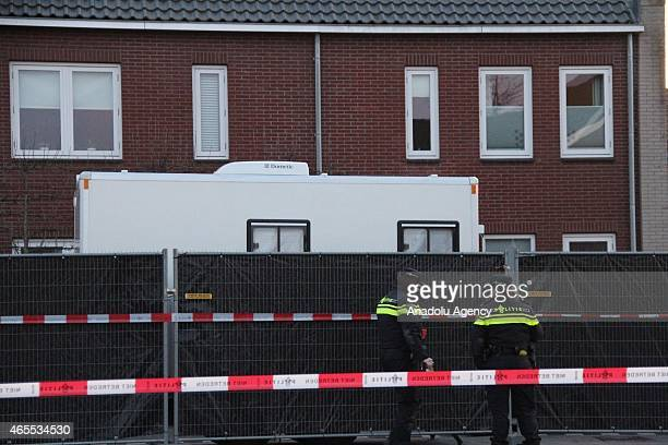 Police inspect the area where three Turks found dead in North Brabant's EttenLeur city Netherlands on March 7 2015