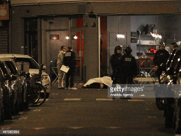 Police inspect the attack scene at Bichat street in central Paris France early on November 14 2015 Reports indicate that more than 140 people overall...