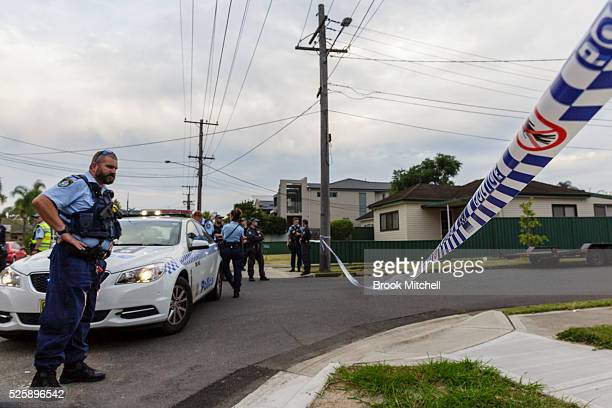 Police inspect the burntout remains of a vehicle used during a shooting at Bankstown Central Shopping Centre on April 29 2016 in Sydney Australia The...