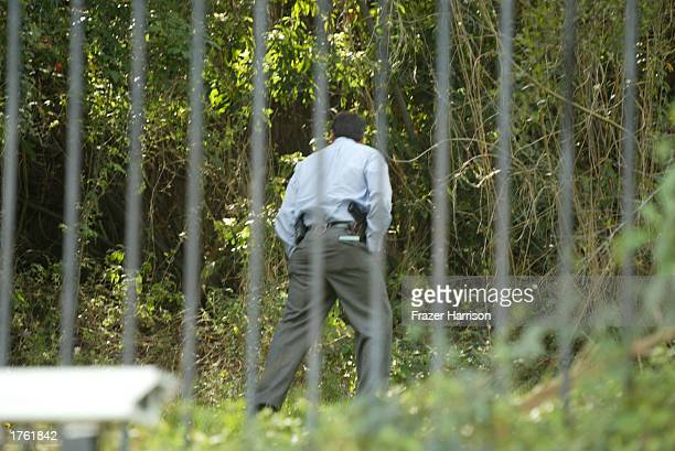 Police inspect the home of record producer Phil Spector on February 4 2003 in Alhambra California Spector was arrested on February 3 2003 for the...