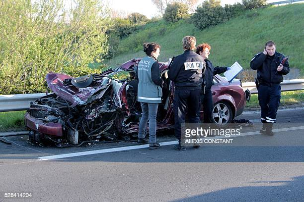 Police inspect the site of an accident on the A16 motorway in Coudekerque near Dunkerque northern France on May 5 2016 One person died and several...