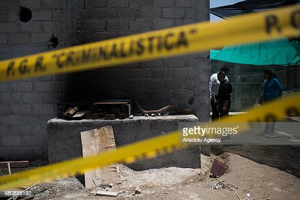 Police inspect the tunnel inside the house where used by Joaquin 'El Chapo' Guzman to escape from the Maximum Security Prison of El Altiplano last...