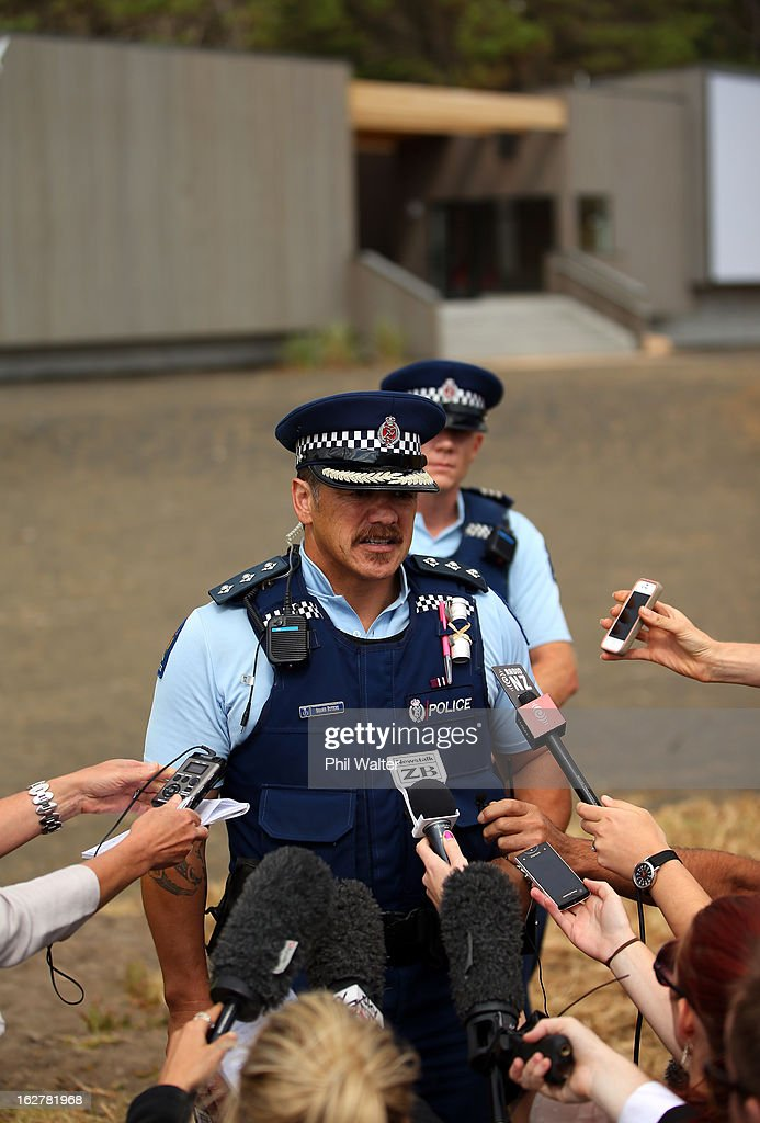 Police Inspector Shawn Rutene speaks to media outside the Muriwai Surf Lifesaving Club after a swimmer died in a fatal shark attack at Muriwai Beach on February 27, 2013 in Auckland, New Zealand. The victim was a local Muriwai man who was swimming several hundred metres from the shore at the time of the attack.