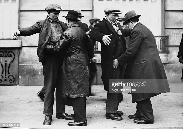 Police inspectors body searching protesters at the Place de la Nation on February 1934 in Paris France