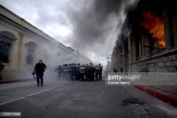 Police intervene in protesters as they gather to stage a protest against the President of Guatemala Alejandro Giammattei, in Guatemala City,...