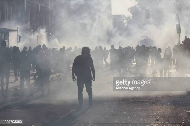 Police intervene in protesters with water cannon and tear gas as they gather to protest against the Chilean President Sebastian Pinera, demanding his...