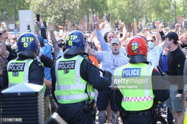 Police intervene the clashes between protesters supporting the Black Lives Matter movement and the opponents at Parliament Square in London on June...