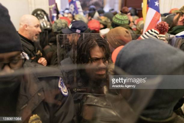 Police intervenes in US President Donald Trumps supporters who breached security and attempt to enter the Capitol building in Washington D.C., United...