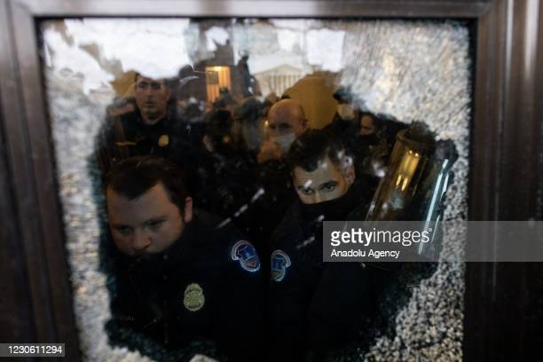 Police intervenes in US President Donald Trumps supporters who breached security and entered the Capitol building in Washington D.C., United States...