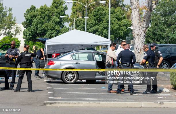 Police investigate a car where a retired Cal State Fullerton administrator was stabbed to death Monday August 19 2019 in Fullerton CA The stabbing...