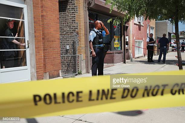 Police investigate a crime scene after two people were shot on the near Westside on June 15 2016 in Chicago Illinois One witness said two area...