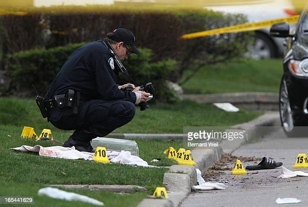 Police investigate a crime scene where a police officer was stabbed in neck overnight Under the grey box is reportedly the knife He is in serious but...