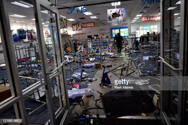 Police investigate a looted clothing store during widespread unrest following the death of George Floyd on May 31 2020 in Philadelphia Pennsylvania...