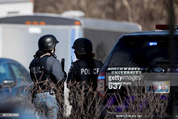 Police investigate a report of shots fired near Northwestern University in Evanston, Ill., on Thursday, March 14, 2018.