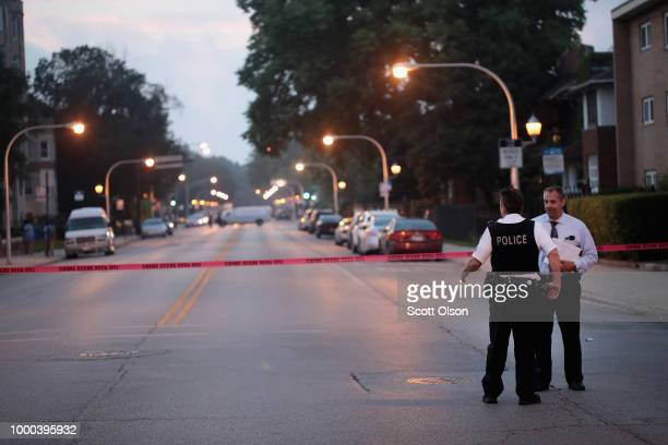 Police investigate a scene where two people were shot on July 16 2018 in Chicago IllinoisThe shooting took place about a block away from were...