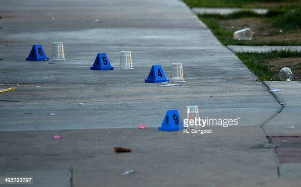 Police investigate a shooting at 27th and Larimer streets in Denver early Monday morning June 2 2014 A man is in critical condition and two other...
