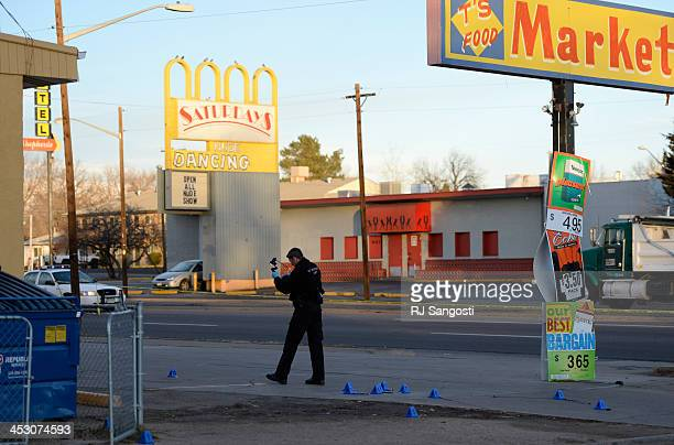 Police investigate a shooting in a parking lot on East Colfax Avenue early Monday morning December 02 2013 A man was taken to a local hospital where...