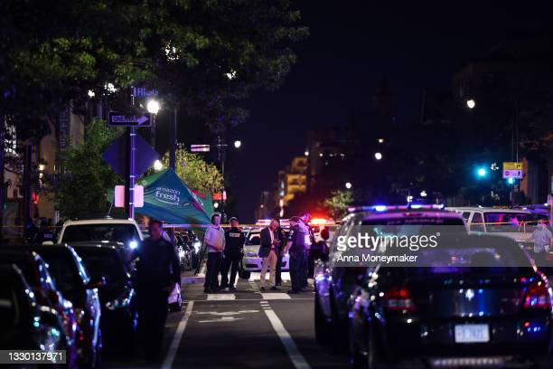 Police investigate a shooting on July 22, 2021 in Washington, DC. Gunfire erupted on a busy street, injuring two and sending others fleeing for...