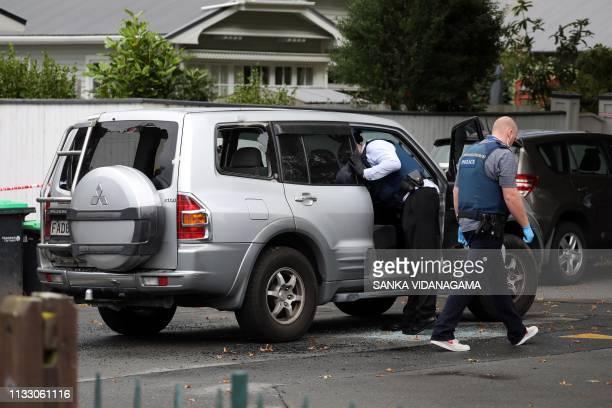 Police investigate a vehicle at the scene where a man died of stab wounds in Christchurch on March 27 2019 Christchurch police launched an urgent...