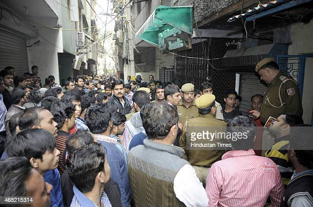 Police investigate after a man named Milan Manjhi was shot dead last night in robbery case at Gali 37 Bidan Pura Karol Bagh on March 4 2015 in New...