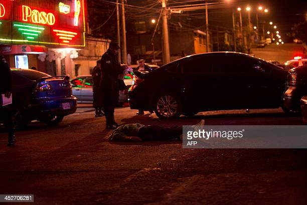 Police investigate at the murder scence outside the 'El Paso Clasico' night club in Guatemala city on November 302013 Alleged members of the Mara 18...