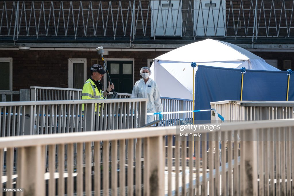 Police At The Scene Of A Burglary That Left One Dead And Two Critically Injured
